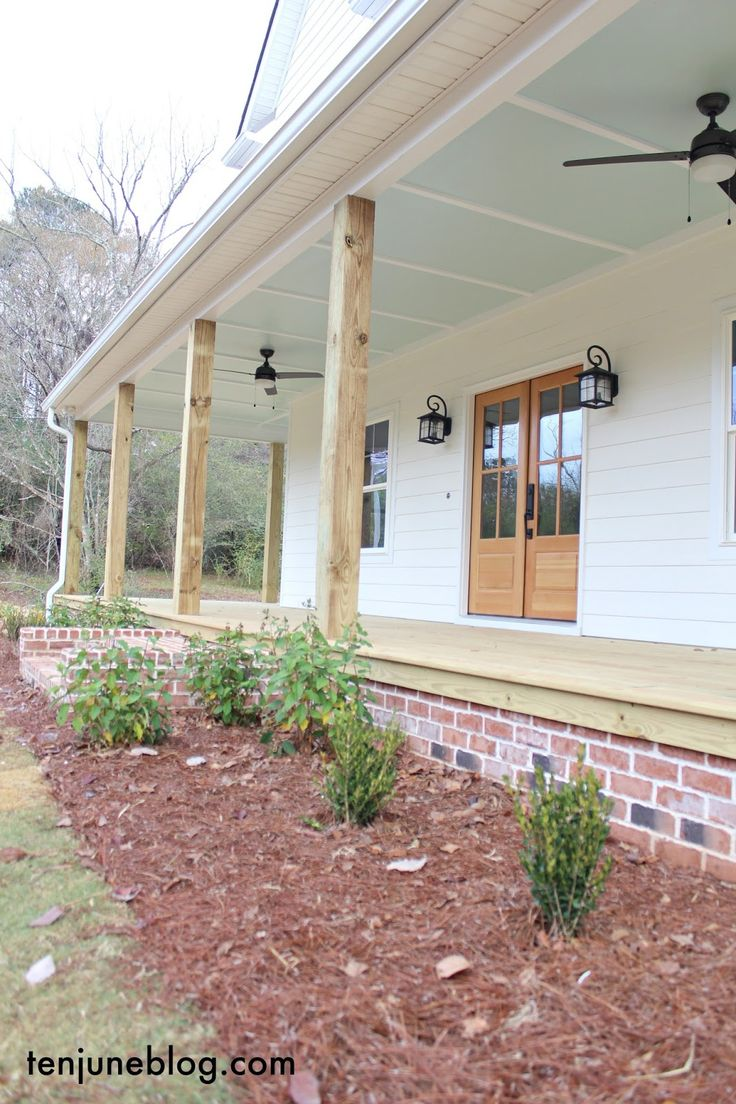 "Ten June: The Farmhouse: A Tour of the Outside. Our front porch with ""haint blue"" painted ceilings and rustic wooden columns. All sources in post! Sherwin Williams paint."