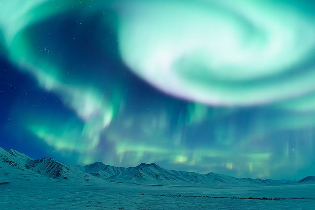 This was the most intense aurora I've ever seen. With a jaw-dropping corona above, dancing curtains, rotating vortices and lightning-like events extending all the way to each horizon, nearly every square inch of the sky – for a full 360 degrees – was filled with color. This was taken about 150 miles north of the arctic circle, during a geomagnetic storm that registered a Kp=6. Moments like this quickly make up for weeks in the unbearable cold.