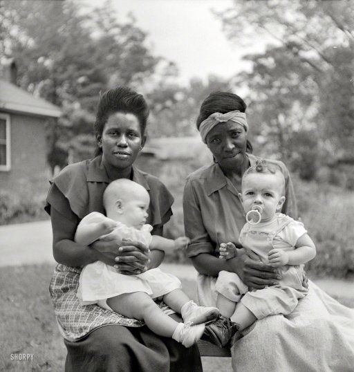 "1951, somewhere in the Southeast. Maids with their employers' babies. Photo by John Vachon for a Look magazine assignment on ""The South"" in what could have been a prologue to ""The Help."""