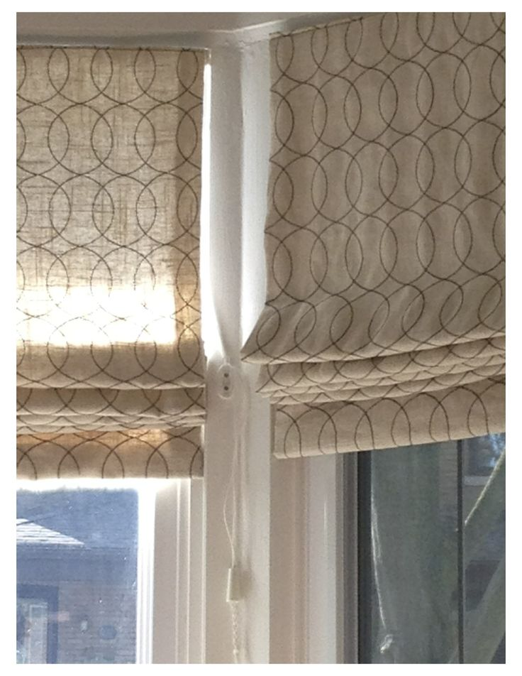 Beautiful large south exposure bay window. Roman shades for night time privacy, but daytime sun!  gate stitch espresso linen fabric by Dwell. For details and your custom romans contact julannavine@gmail.com