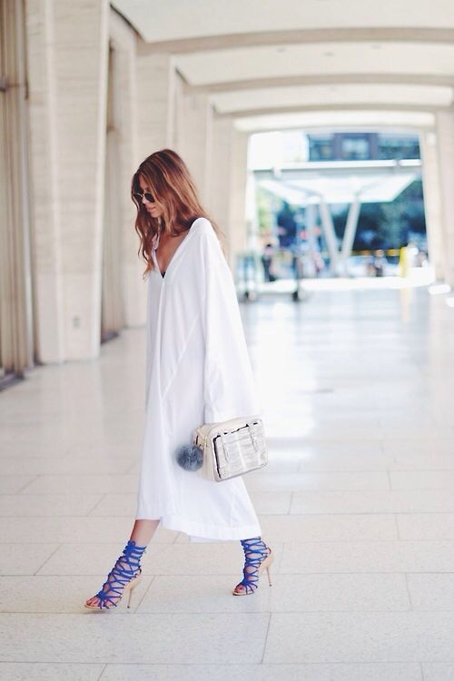 Modern Grecian goddess... adore the combo of that super unstructured dress against those fierce heels in colour pop electric blue... cute pom pom detail too.  Gorgeous.