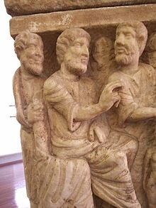 The earliest known depiction of the Trinity, Dogmatic Sarcophagus, 350 A.D.[30] Vatican Museums.