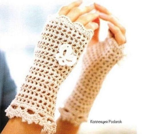 Beige mittens adorned with a white butterfly...tons of mittens and glove patterns on this page