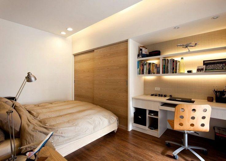 chambre adulte avec armoire encastrée et bureau maison