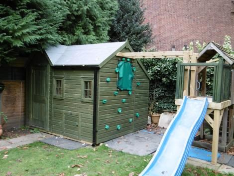 Awesome Playhouse With Storage Shed And Climbing Wall