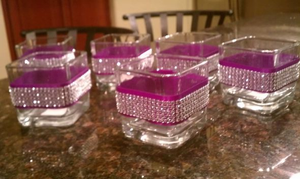 wedding center piece bling. choose your own wedding colors. pick up some tealight holders from the dollar store, wrap with your wedding colored ribbon and some bling mesh available at most fabric stores.. also in colors..