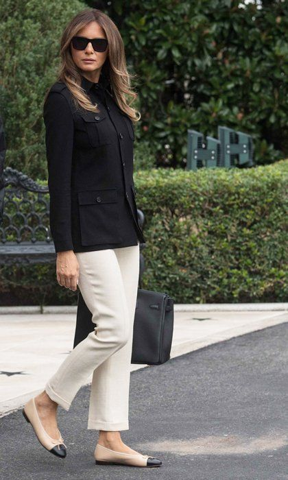09e0d378a87 Barron Trump s mom stayed neutral on her way to Florida in Marine One in a  structured black Ralph Lauren jacket and off-white capris.