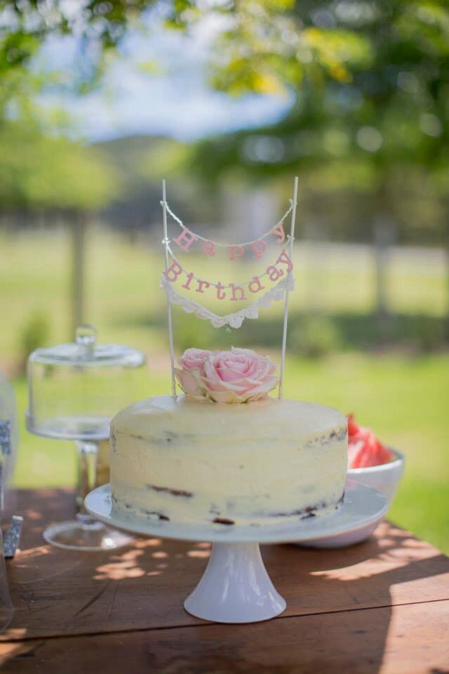 Birthday cake. Fresh flowers, homemade bunting by me Poppymoss photography