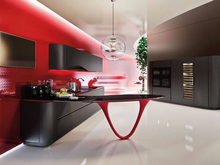 The Kitchen Countertop Is Made Of Gl With A Gloss Finish While Sculptural Leg