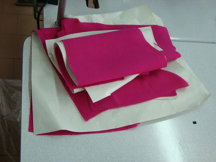 Cutting the fabric following the pattern Proudly Made in Italy