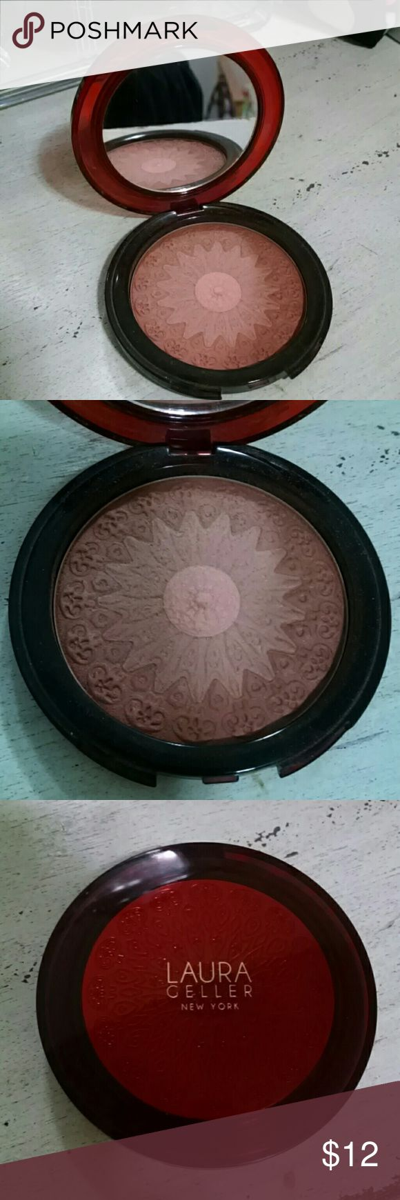 Laura Geller Moroccan Bronzer From the Laura Geller Mediterranean Set, this is a beautiful baked bronzer. It has a shimmer so it can also be used as a highlighter. Mirror compact. Barely used, I'm stuck on my Mac bronzers lol. No box.100% AUTHENTIC!!! Bundle and save on shipping costs!!! Laura Geller  Makeup Bronzer