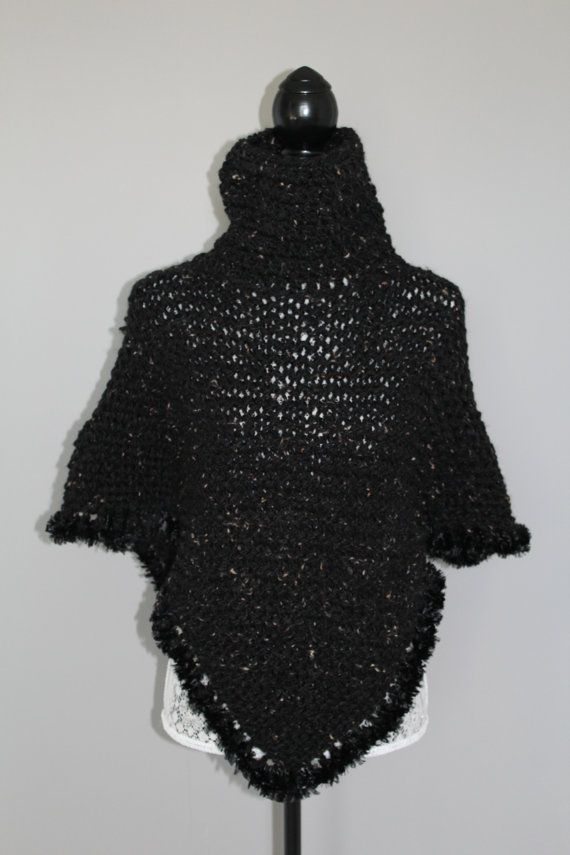 Hand made crochet poncho with cowl neck in black tweed patterned yarn with faux fur edging. Fits small-medium size. Great for wear in the
