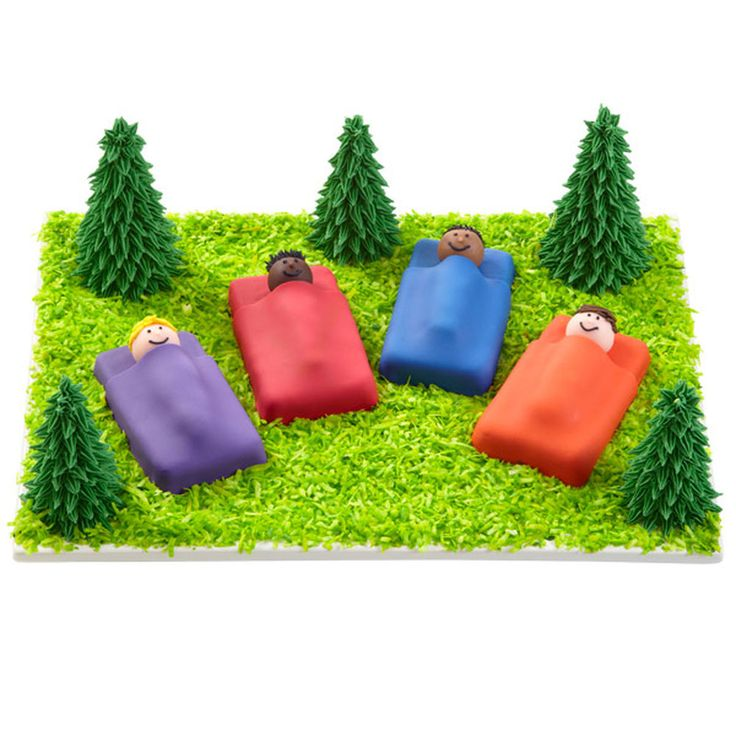 Nothing says summer like sleeping under the stars! These sweet mini cakes and sugar ice cream cone trees are fantastic to serve at camps, birthday parties and scout meetings. The Wilton Mini Loaf Pan is the base of the sleeping bags!