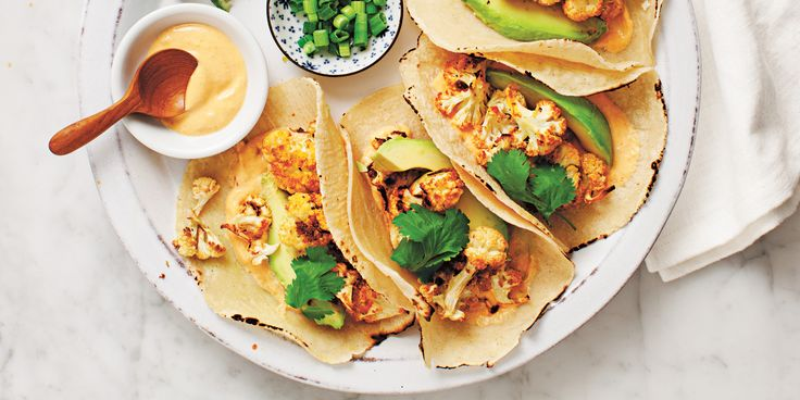 Roasted Cauliflower Tacos with Chipotle Cream via @iquitsugar