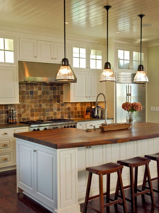 Butcher block counter top brick backsplash design Island pendant lighting ideas