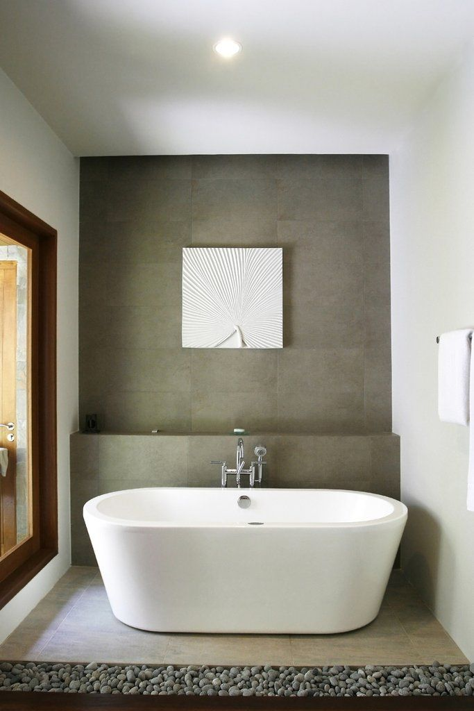 """A 65"""" freestanding acrylic dual ended bathtub with no rim holes. This tub is designed for symmetry with straight lines leaning out slightly from the floor to the edge of the tub. Chrome drain is inclu"""
