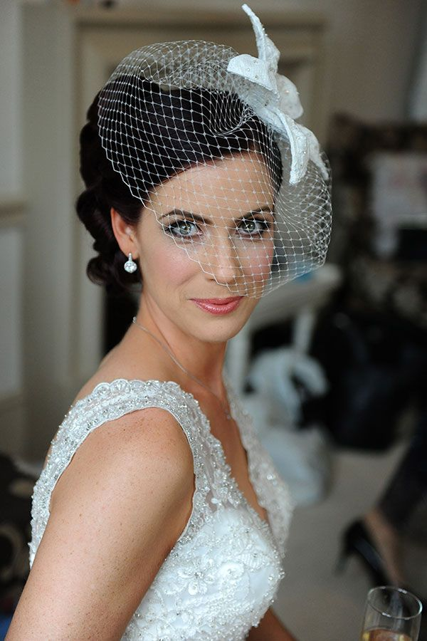 Birdcage veil and fascinator. | Photo: Surrey Lane wedding photography, London