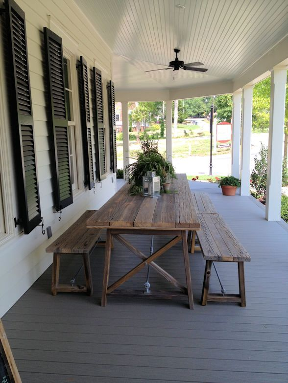 Wooden table on the veranda with benches