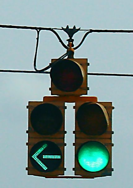 The Multiplication Technique. A traffic light with a turn signal light. This type of traffic light uses multiple green and yellow lights to signal when the designated traffic lane can turn and not.