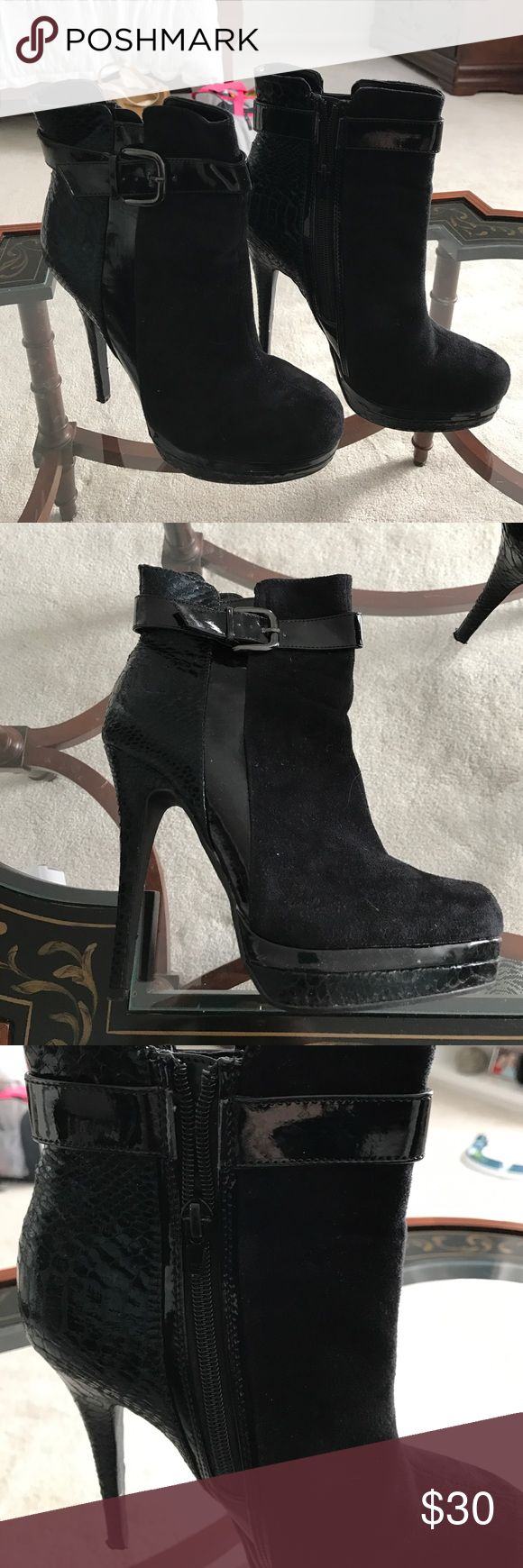 Black high heeled booties Gorgeous black high heeled booties. With inside zipper. Suede and lizard type material. They look amazing on and really make an outfit look sexy and cool. Comes in box. Lightly worn once Call It Spring Shoes Heels