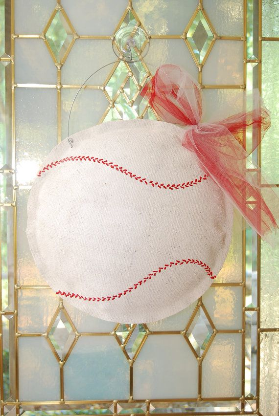 baseball made from burlap....I am making me one for my front door this weekend! I am going to use deco mesh for the bow instead of the tulle