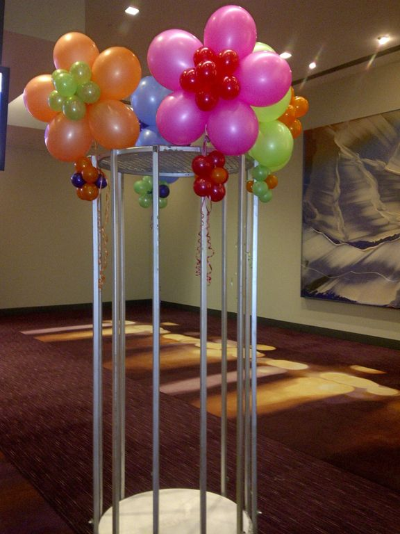 bushels of #flowers #balloons #corporateevents #companyparty #eventstoronto #ballooncorporateevents #summerparty #holidayparty #eras #decades #themedevents