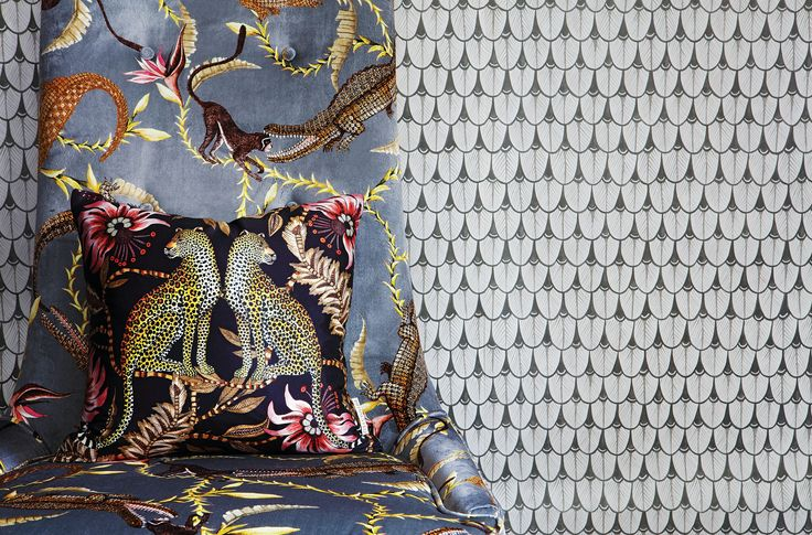 Zambezi high-backed chair in velvet River Chase Silver Ripple, and a silk Lovebird Leopard scatter cushion.