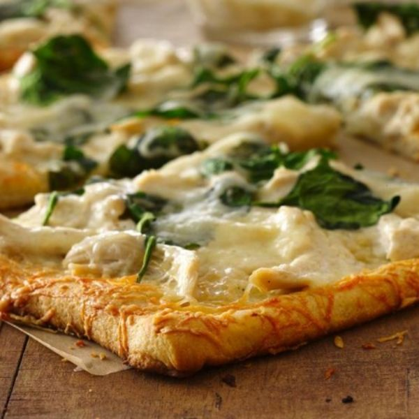 Alfredo pizza with a super easy and fancy-looking Parmesan crust.