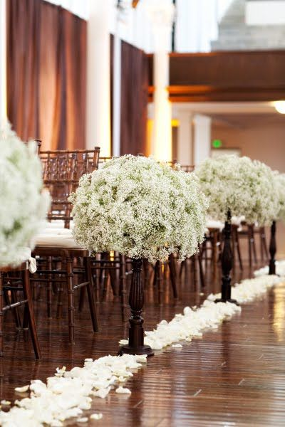 I love these babys breath along the aisle. They would make great table centerpieces too!