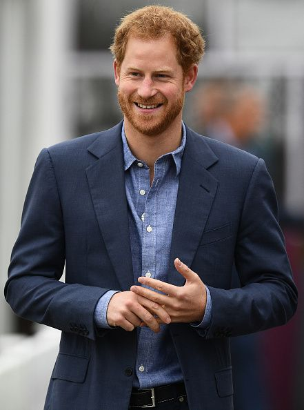 Britain's Prince Harry smiles as he arrives at Lord's cricket ground in London on October 7, 2016, to participate in a Coach Core sports coaching apprenticeship programme event.