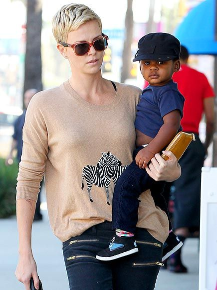 We seriously can't get over how CUTE Charlize Theron's baby boy Jackson is! But we also love this mommy's translucent peach sunnies! FAB!