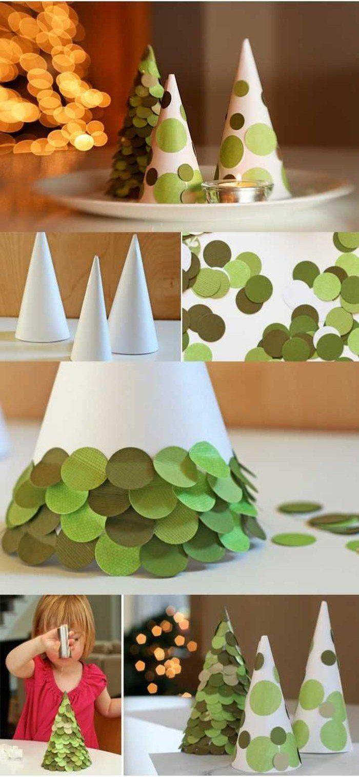 des cônes de papier décorés de plusieurs cercles en papier vert et transformés en sapins de Noël