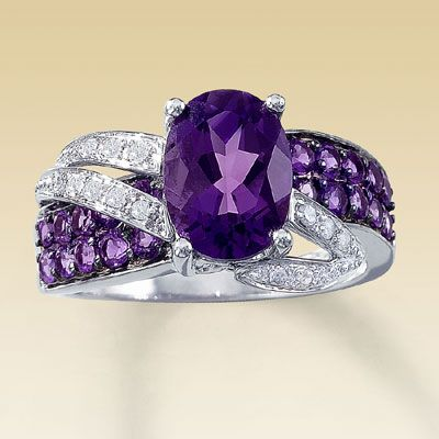 I rather a different shaped diamond in the middle.  amethyst engagement rings | Unique Oval Amethyst Wedding Rings | Wedding Rings