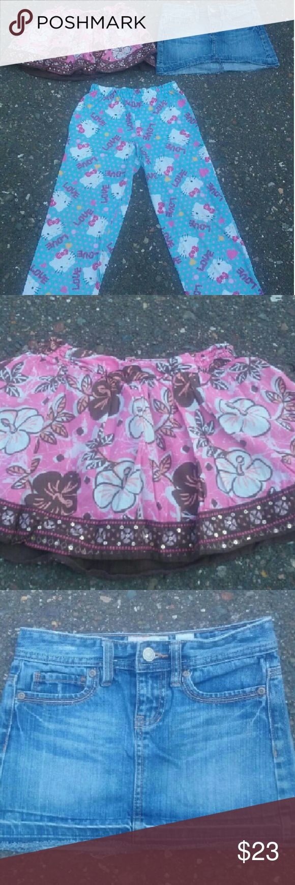 Girls clothing bundle . Hello Kitty pj's pants. Normal wear and tear but no stains and tears. Size 7/8.  . Old Navy denim skirt. Excellent condition. Size 7. . Justice skirt size 7. Stain in the front that blends in with the print. Has built in shorts. Other