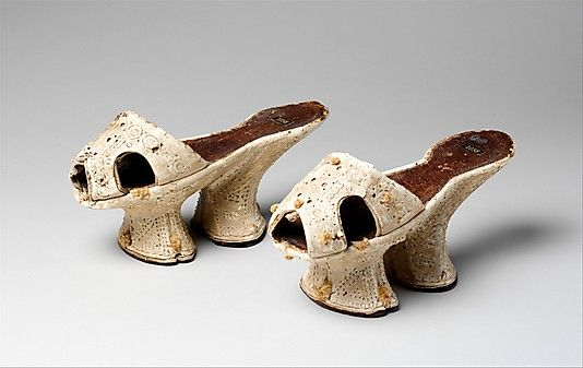 Chopines  Date:     ca. 1600 Culture:     Italian Medium:     leather, silk, wood Dimensions:     Heel to Toe: 8 3/4 in. (22.2 cm) Accession Number:     1973.114.4a, b
