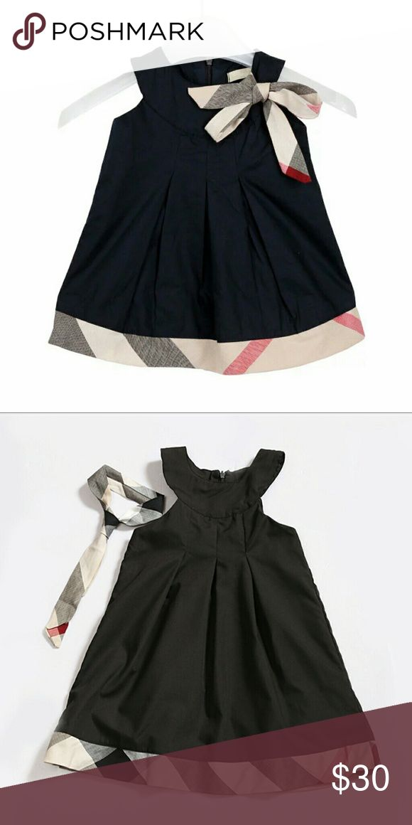 Baby girl dress with Burberry pattern Cute little girl dress. Not authentic just has the Burberry pattern. 2-3 year old Dresses