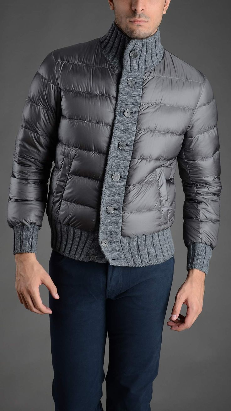 Quilted down jacket with collar, cuffs an borders in knitted wool, two welt pockets, button fastening, gose down padding, 100% polyammide. #herno