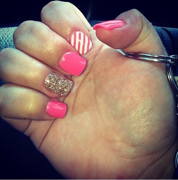 Hot pink and gold glitter gel nails thanks to Sara at Midtown Salon