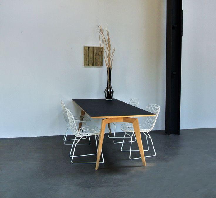 The Flo dining with a top of desktop and oak legs - designhart.nl - #tafel #Flo #Designhart