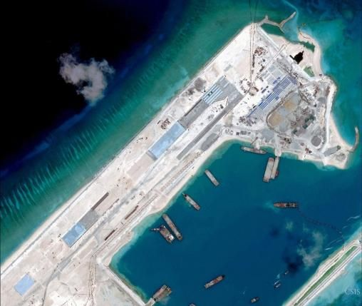 Images show rapid Chinese progress on new South China Sea airstrip | Reuters