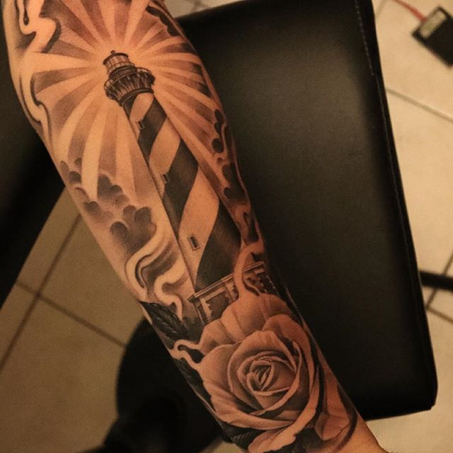 Rose tattoo by Eric Marcinizyn (Bullseye Tattoo)
