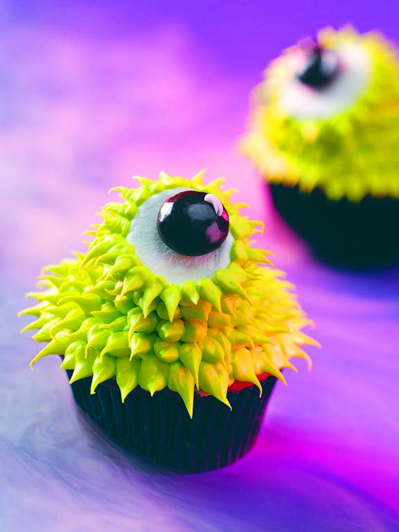 I made these CUTE eyeball cupcakes for both my son's Halloween Parties at school. They were a HUGE hit!  The kids loved them and the adults loved how easy they were to make.  I found the recipe here. :)