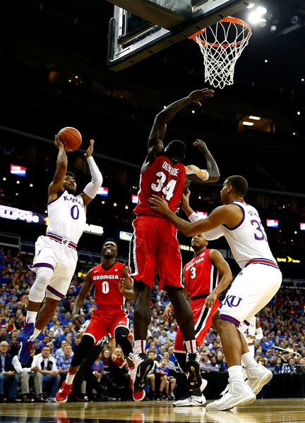 Frank Mason III #0 of the Kansas Jayhawks shoots during the CBE Hall of Fame Classic Championship game against the Georgia Bulldogs at the Sprint Center on November 22, 2016 in Kansas City, Missouri.