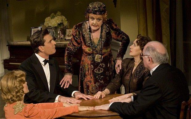"""Deborah Rush, Rupert Everett, Angela Lansbury, Jayne Atkinson and Simon Jones are shown in a scene from the revival of Noel Coward's """"Blithe Spirit""""."""