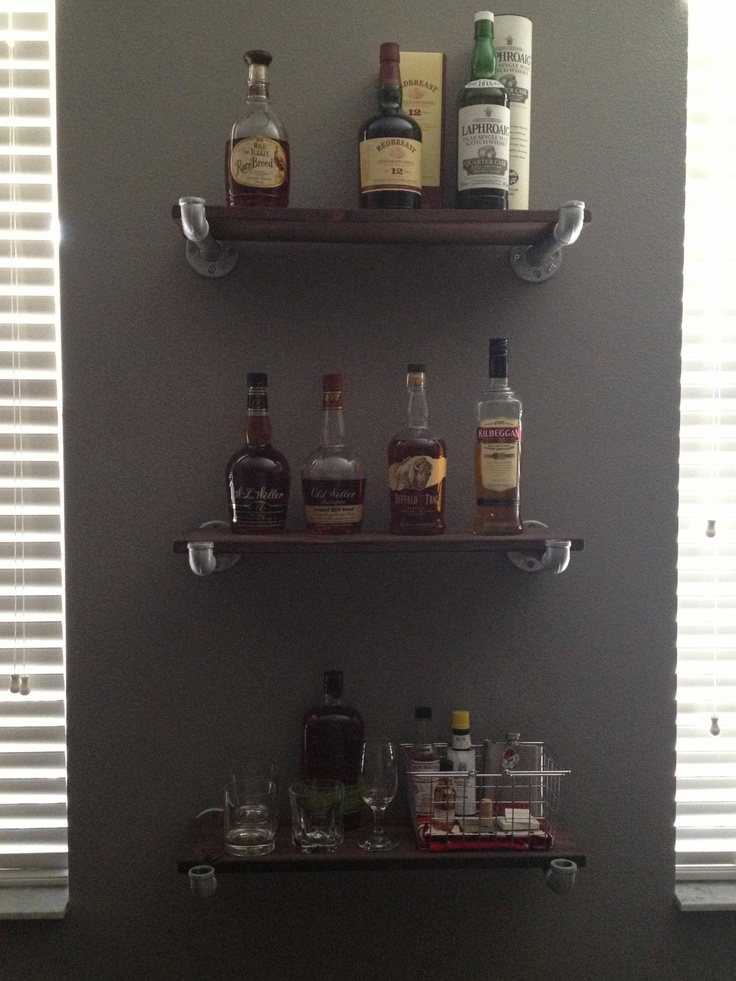 Whiskey shelves -- note pipe supports
