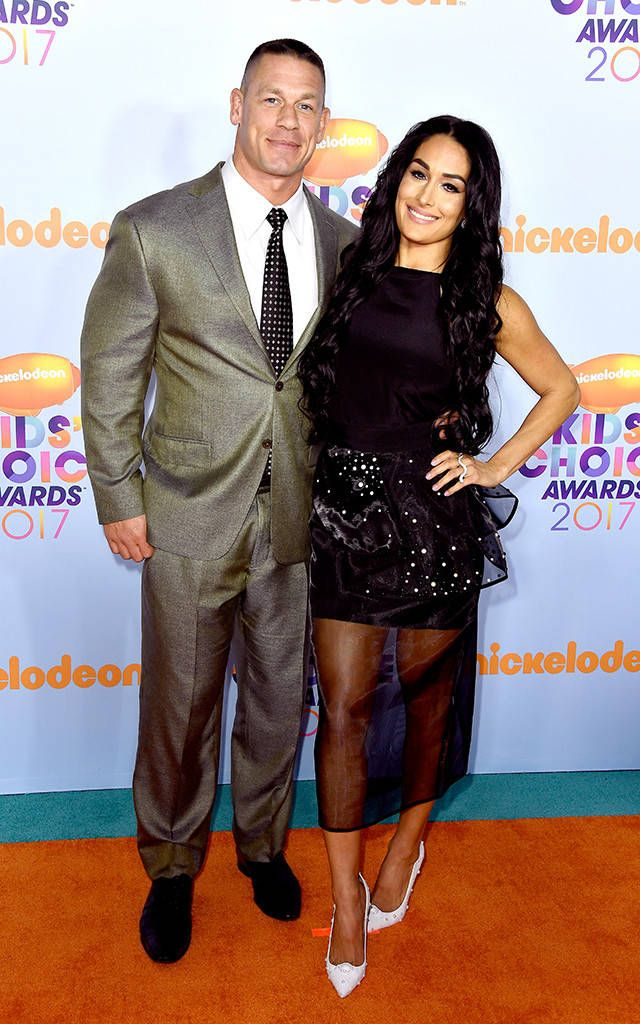 John Cena & Nikki Bella from Kids' Choice Awards 2017: Red Carpet Arrivals  Shortly before the WWE superstar takes the stage to host the 2017 KCAs, he cozies up to his wife for a sweet photo opp.