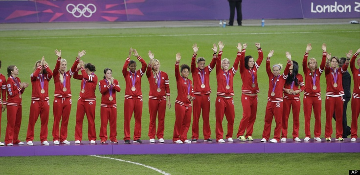 Canada bronze-medalist women's soccer players acknowledge the crowd at the 2012 Summer Olympics, Thursday, Aug. 9, 2012, in London.