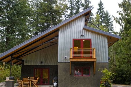Modern passive solar home - love asymmetrical roofline, materials, and outdoor space