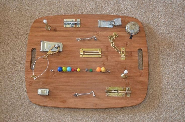 Busy board for 18 moth old son - he loves it, especially the door jams and bike bell