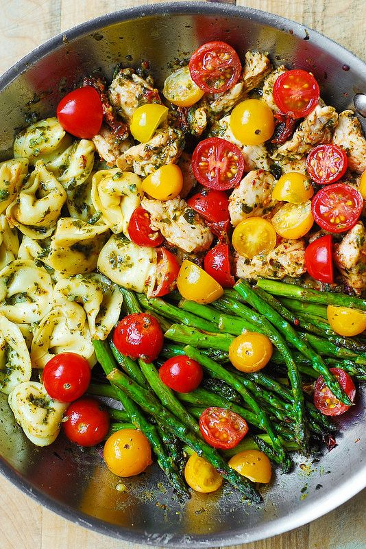 One-Pan Pesto Chicken, Tortellini, and Veggies. Just used to recipe as a guideline and it turned out really well! Swapped green beans for the asparagus and Italian sausage for the tortellini, and used more tortellini than called for.